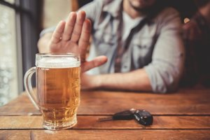 a man says no to another beer during national impaired driving prevention month 2018